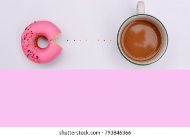 Flat lay strawberry donut and coffee cup on white with pink copy space background.