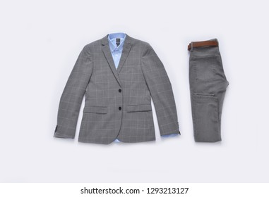 Flat lay stripy suit with blue shirt with pants close up