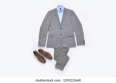 Flat lay stripy suit and blue shirt and leather shoes