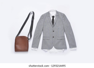 Flat lay stripy suit ,tie with white shirt and leather handbag close up
