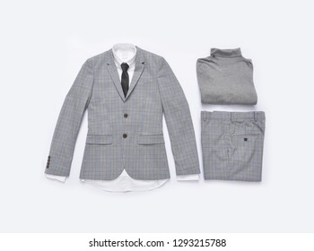 Flat lay stripy suit with tie and white shirt ,sweater close up
