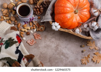Flat lay style of autumn and thanksgiving concept with coffee, pumpkins and cinnamon sticks on pastel color, top view.