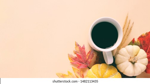 Flat lay style of autumn and thanksgiving with pumpkin, coffee and maple leaf, copy space and banner style for text and design