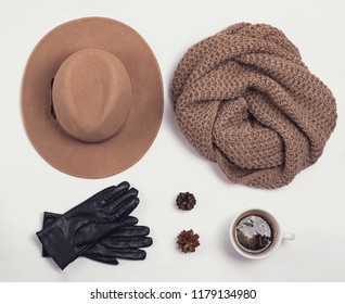 Flat lay with stylish feminine autumn or winter accessories on the white background.