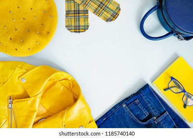 Flat lay stylish girl clothes blue and yellow combination.