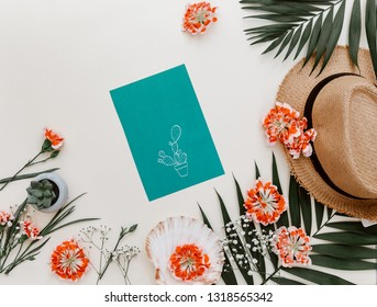 Flat lay stylish lifestyle background. Top view with greeting card, flowers on pastel background. Composition for bloggers, magazines