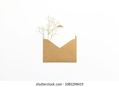 Flat lay stylish mockup photo with envelope, greeting card and gypsophila flowers. Feminine photo for blog and website.