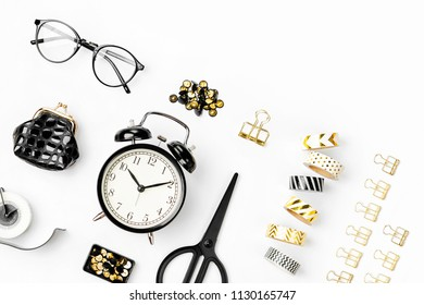 Flat lay stylish set: alarm clock, washi tape,  paper clips, note on white background. Flat lay, top view. Business Stationery concept.