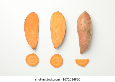 Flat lay with sweet potato on white background, top view