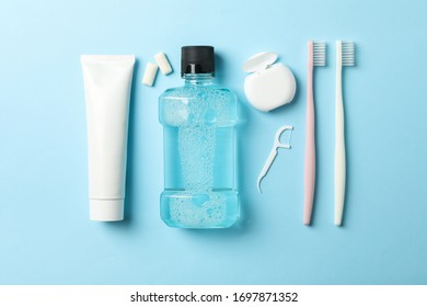 Flat lay with tools for dental care on blue background