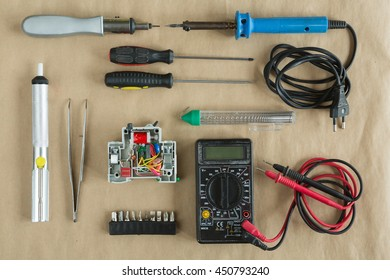 Flat lay of Tools for electrician Repair - multimeter , tweezers, residual current device, soldering iron , solder , bits , differential machine