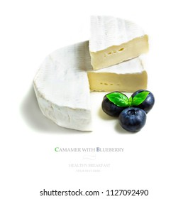 Flat lay, top camembert cheese on isolated white background. Seamless pattern with camembert cheese with blueberry abstract background. Concept of space for text, your text here.