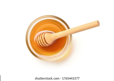 Flat lay (top view) of Glass bowl of pure honey with honey dipper isolated on white background. Clipping path.