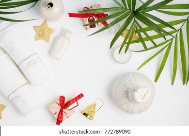 Flat lay top view holiday spa background: thai massage bag, towels and gift boxes on blue background. Healthy lifestyle. Text space