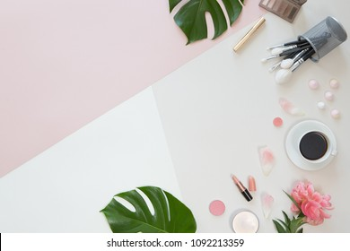 Flat lay and top view of make up products on white pink background with copyspace. Beauty concept for blogger, pastel women business office table desk