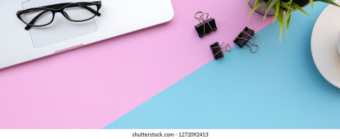 Flat lay of top view modern desk blue&pink pastel color tone work table dimention ratio for facebook cover page