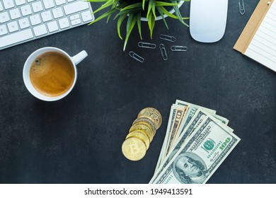 Flat lay top view office desk, bitcoin and dollars money