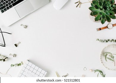 Flat lay, top view office table desk frame. feminine desk workspace with laptop, diary, succulent, glasses, watch on white background.