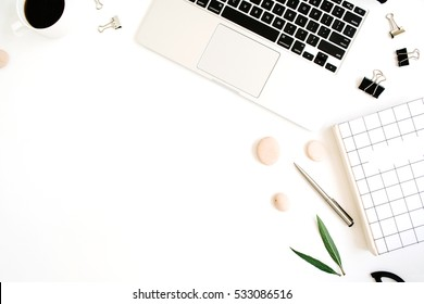 Flat lay, top view office table desk. Workspace with notebook, laptop, coffee cup, scissors and clips on white background.
