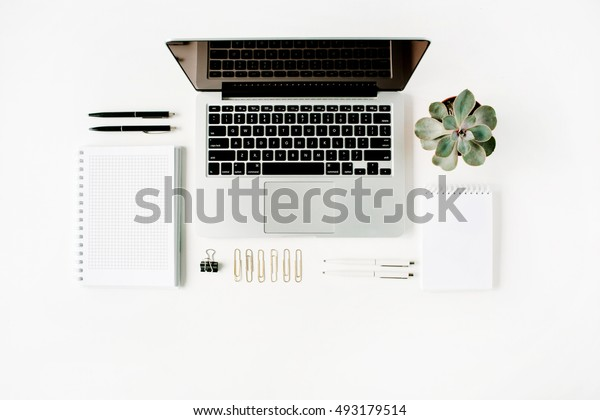 Flat lay, top view office table desk. Workspace with laptop, diary, succulent and glasses on white background.