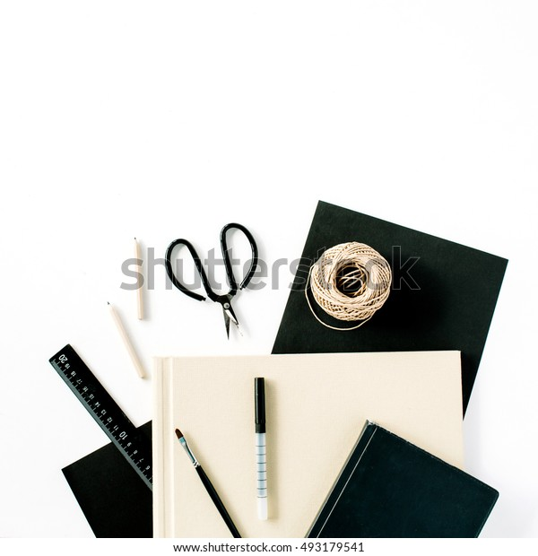 Flat lay, top view office table desk. Workspace with scissors, pencils, succulent and diary on white background.