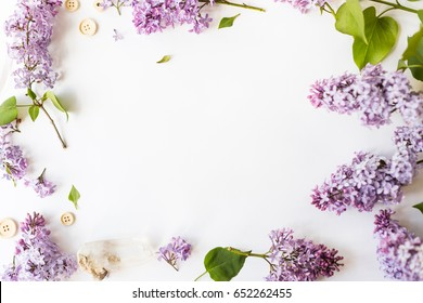 Flat lay top view photo of spring composition. Wreath made of   a lilac flowers on white background. Summery floral mock-up.