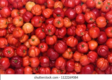 Flat lay (top view) of Red Acerola cherry texture pattern background