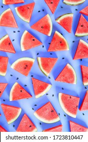 Flat lay, top view Sliced watermelon on blue background. Watermelon pattern.
