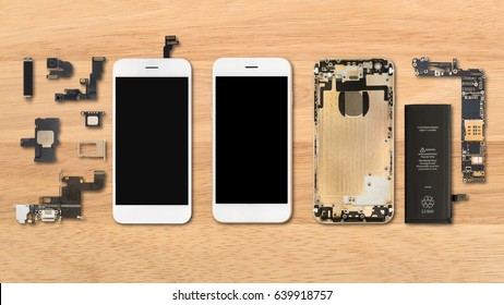Flat Lay (Top view) of smartphone components on wooden background