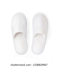 Flat lay (top view) of Soft white home or spa slippers isolated on white background with clipping path.