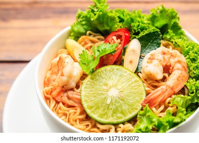 Flat lay, top view Spicy instant noodles soup with shrimp tom yum