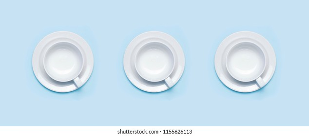 Flat lay top view three White empty ceramic cup on a saucer on blue background. Concept morning breakfast, drink coffee or tea. Background utensils, kitchen items. Minimalistic background