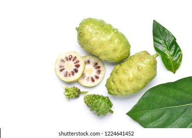 Flat lay (Top view) various of Noni or Morinda Citrifolia fruits with sliced and green leaf isolated on white background