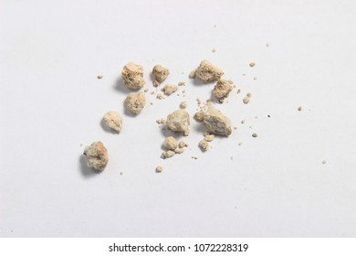 flat lay or top view very small kidney stones with ruler at white background