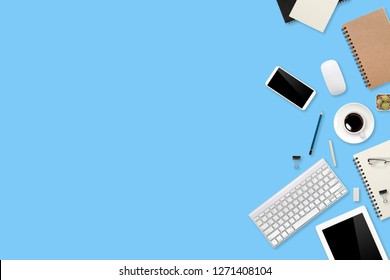 flat lay or top view workspace office blue desk with laptop computer, coffee cup and smartphone using for business background