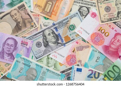 Flat lay or top view of world international banknotes vary countries background. US Dollar, Chinese yuan, Japanese yen, Euro, Indian rupee, Thai baht. Concept of Forex or global financial economic.