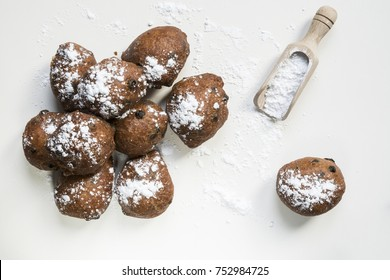 flat lay traditional oliebollen, oil dumpling or fritter, with wooden spoon, for Dutch New Year's Eve