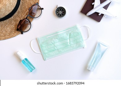 Flat lay of travel accessories , sanitizer, alcohol spray and protective face mask. Health care concept. Top view with copy space.