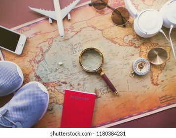 Flat lay, Travel planning concept on map, smartphone, model plane, headphone and magnifying glass, minimal style.
