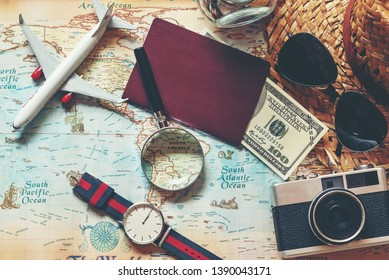Flat lay of Traveler accessories and items man with backpack  for planning and visiting travel vacations on the world and working business for weekend.  Travel and Summer holiday concept