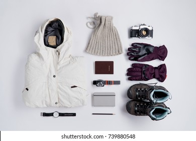 Flat lay of Traveler's accessories in winter season, Essential vacation items, Travel concept background.