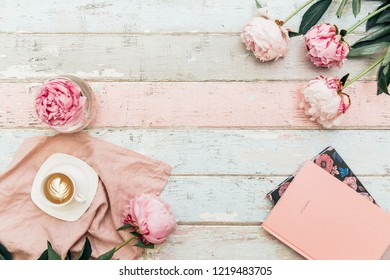 Flat lay trendy background . Coffee with notebook, and peony flower