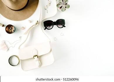 Flat lay trendy creative feminine accessories arrangement. Purse, hat, sunglasses, female accessories. Top view
