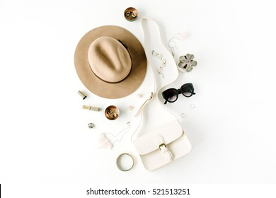 Flat lay trendy creative feminine accessories arrangement. Purse, hat, sunglasses, female accessories. Top view