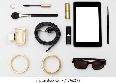 Flat lay trendy creative feminine accessories arrangement. Flat lay