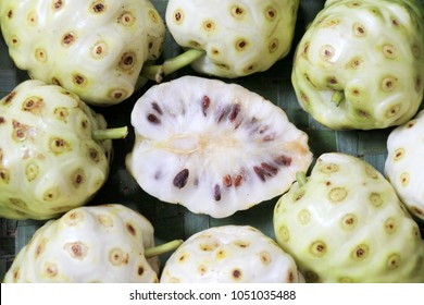 Flat lay view of Cheese fruit Noni fruit (Morinda Citrifolia plant) in Rarotonga, Cook Islands. Noni juice has been promoted as a cure for a number of human diseases. Food background and texture.