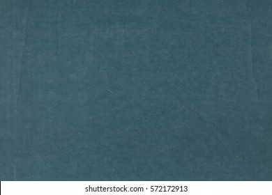 Flat Lay View of Dark, Moody Teal Toned Cardboard with creases and corrugated as a plain background space for your text, copy, words or design.  Horizontal that can be used vertical.