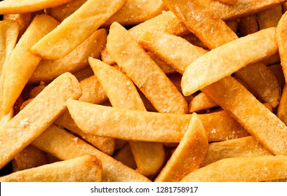 Flat lay view of steak french fried pommes or chips in full frame macro photography