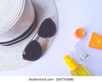 Flat lay view of summer and travel accessories. Hat, sun glasses, sunblock cream protection.