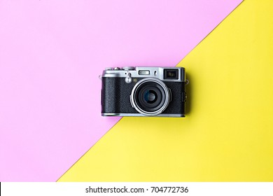 Flat lay vintage camera  on pastel background